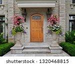 elegant wooden front door of... | Shutterstock . vector #1320468815