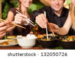 young people eating in a thai... | Shutterstock . vector #132050726