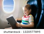 child in airplane. kid with...   Shutterstock . vector #1320577895