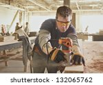 carpenter at work at industrial ... | Shutterstock . vector #132065762
