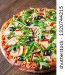 pizza with mozzarella cheese ... | Shutterstock . vector #1320744215