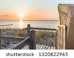 Sunset And Beach Chair At The...