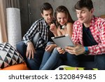 happy young people using tablet ...   Shutterstock . vector #1320849485
