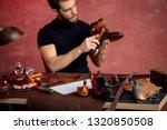 focus on clean black shoe on... | Shutterstock . vector #1320850508
