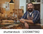handsome mature bearded male... | Shutterstock . vector #1320887582