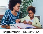mother and daughter doing...   Shutterstock . vector #1320892265