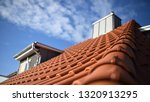 red roof house with red tiles... | Shutterstock . vector #1320913295