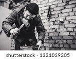the blacksmith manually forging ...   Shutterstock . vector #1321039205