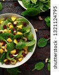 mango spinach salad with dried... | Shutterstock . vector #1321124795