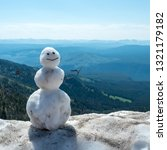 A Snowman Perches A Ridge - Fine Art prints