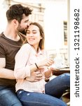 young couple in love enjoying a ... | Shutterstock . vector #1321198682