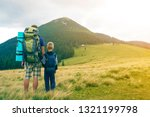 father and son with backpacks... | Shutterstock . vector #1321199798