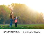 young child girl points in... | Shutterstock . vector #1321204622