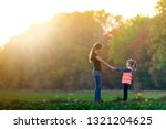 back view of young slim... | Shutterstock . vector #1321204625
