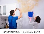 woman collecting water in blue... | Shutterstock . vector #1321321145