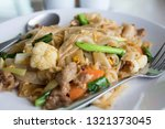 stir fry noodles  in white bowl.   Shutterstock . vector #1321373045