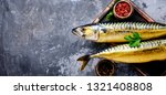 Stock photo appetizing smoked fish on kitchen board smoked mackerel mediterranean food 1321408808
