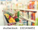 shopping cart filled with... | Shutterstock . vector #1321436852