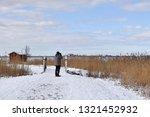 birdwatcher watching in a... | Shutterstock . vector #1321452932