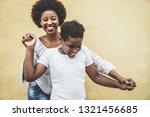 happy young mother having fun...   Shutterstock . vector #1321456685