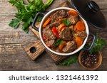 beef stew with vegetables in... | Shutterstock . vector #1321461392