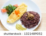 rice with omelette on plate   Shutterstock . vector #1321489052