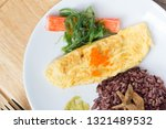 rice with omelette on plate   Shutterstock . vector #1321489532