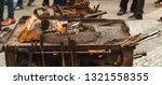 old blacksmith tools on the... | Shutterstock . vector #1321558355