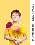 cute boy with bouquet gerbera... | Shutterstock . vector #1321749398