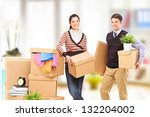 young man and woman moving into ... | Shutterstock . vector #132204002