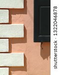 Small photo of Closeup abstract view of white quoin and part of black shutter in Charleston, South Carolina