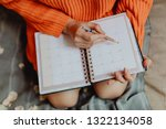 woman writing on her daily... | Shutterstock . vector #1322134058