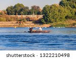 two egyptian men fishing with... | Shutterstock . vector #1322210498