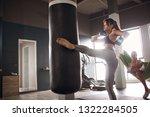 sports woman doing kickboxing...   Shutterstock . vector #1322284505