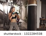boxing training. woman boxer... | Shutterstock . vector #1322284538