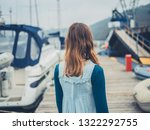 a young woman is walking around ... | Shutterstock . vector #1322292755