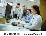 people working in a busy office ... | Shutterstock . vector #1322292875