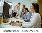 people working in a busy office ... | Shutterstock . vector #1322292878