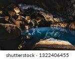 grjotagja lava cave  near... | Shutterstock . vector #1322406455