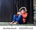 happy kid wearing warm clothes... | Shutterstock . vector #1322491112