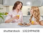 joyful girl and woman sitting... | Shutterstock . vector #1322494658