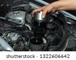 replacement of oil filter | Shutterstock . vector #1322606642