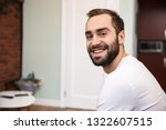close up of a smiling young man ... | Shutterstock . vector #1322607515