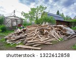 pile of planks after renovation ... | Shutterstock . vector #1322612858