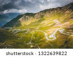 aerial view on a winding road... | Shutterstock . vector #1322639822