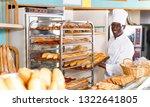 adult african american baker... | Shutterstock . vector #1322641805