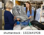 woman receiving her clean... | Shutterstock . vector #1322641928
