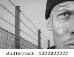 Small photo of Portrait of guy with teardrop and face tattoo. Criminal, convict and prison tattoos concept