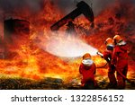 Team Firefighters during battle and explosion of fire bomb in the midst of fire at oil and gas industry with mission successful for protect with emergency case  for danger mission - stock photo