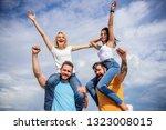 cheerful couples dancing.... | Shutterstock . vector #1323008015